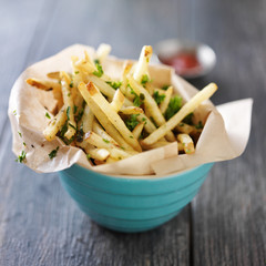 truffle fries in bowl lined with wax paper