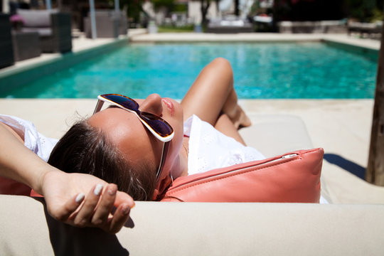 Portrait of a beautiful woman on vacation in luxury resort