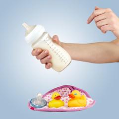 Mother prepares baby milk formula.