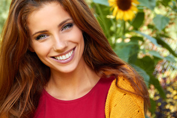 beautiful woman in an autumn garden