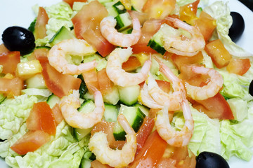 The image of salad with the shrimps