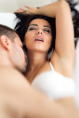 Woman having sex feeling pleasure