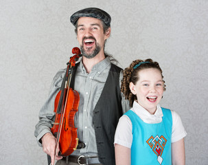 Laughing Celtic Fiddler and Girl