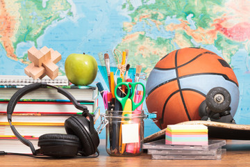 School accessories on desktop with map in the background