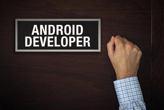 Businessman knocking on Android Developer door