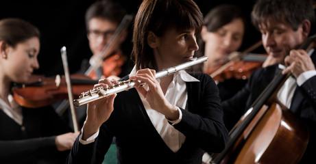 Classical music concert: flutist close-up