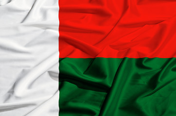 Madagascar flag on a silk drape waving