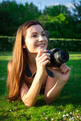 Girl with the camera in the park