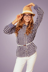 young pretty womanl with retro garb touching her hat and glasses