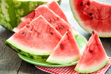 Ripe watermelons on table on the wooden background
