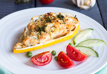 stuffed zucchini with chicken and vegetables, horizontally