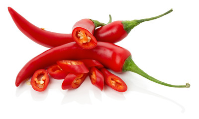 red chilly peppers with slices isolated on the white background