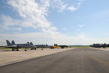 Miitary aircraft parked on the runway at an airshow