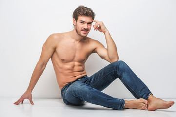 Handsome guy in jeans with bare torso.