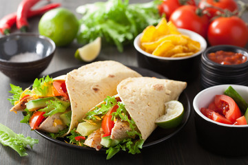mexican tortilla wrap with chicken breast and vegetables
