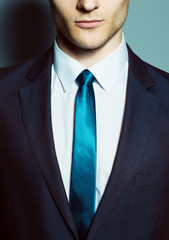 Portrait of a young handsome man (businessman) in classic suit,
