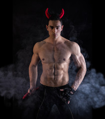 Sexy Young Man Wearing Horns and Tail as Devil