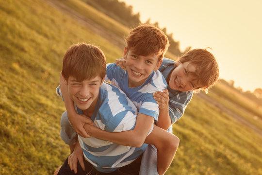 Portrait of three happy cheerful brothers