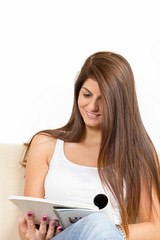 girl reading on the sofa and smiling