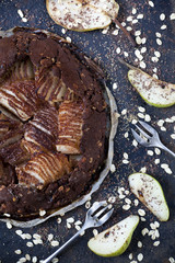 homemade pears and dark chocolate tart  with oat flakes
