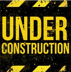Yellow - black grunge sign Under Construction