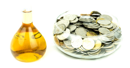 Concept of coins and money savings on petrol fuel or palm oil
