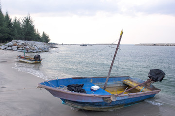 Small fishing wooden boats in the sea