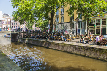Amsterdam, Netherlands. Summer cafe on the city street