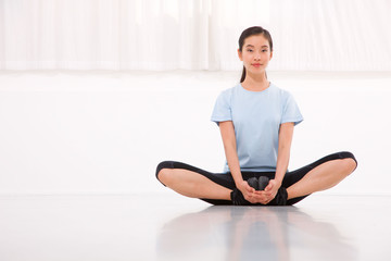Young asian woman exercising