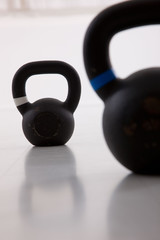 Two black iron kettlebell for weightlifting and fitness