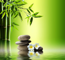 Wall Mural - spa background with bamboo and stones on water