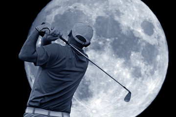 golf swing and a big moon