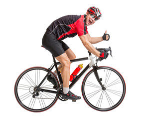cheerful cyclist with winning gesture riding a bike