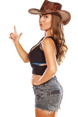 woman with a cowboy hat posing with a finger up