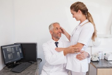 Dentist and dental assistant embracing inappropriately