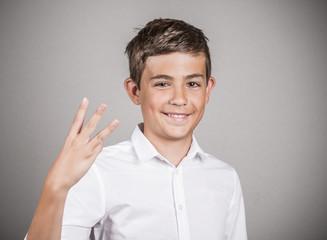 Teenager showing three fingers, number three gesture