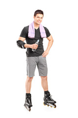 Man on roller skates holding a water bottle