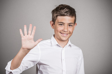 Handsome teenager showing 5 fingers palm, number five gesture