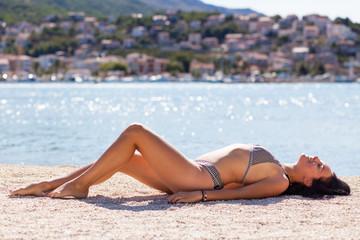 Young beautiful woman sunbathing