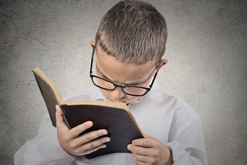 Boy, teenager having difficulty to read text, vision problems.