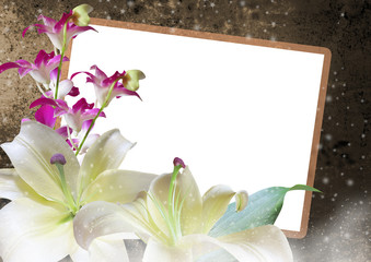 Lilies and orchids with photo frame on romantic background