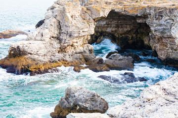 Waves spalshing on rocks