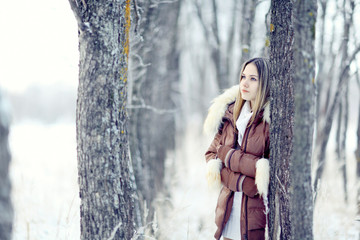 young woman in winter jacket with fur hood