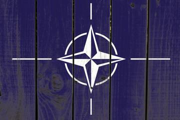 Nato flag on wooden background