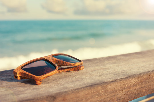 wooden sunglasses and the sea