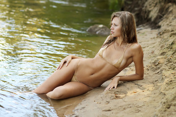 beautiful girl in a bikini in water