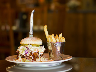 Pulled pork and cole slaw sandwich with garlic fries