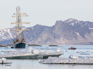 Yacht in the Arctic fjord - Spitsbergen, Svalbard