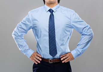 Businessman with hand on waist