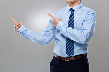 Businessman with two finger point up